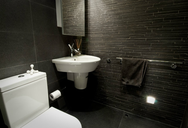 modern-wood-house  Tiny Wooden Apartment in Hong Kong bathroom slate tile